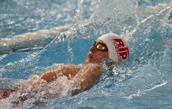 Neo breaks club records in 50 and 100 back
